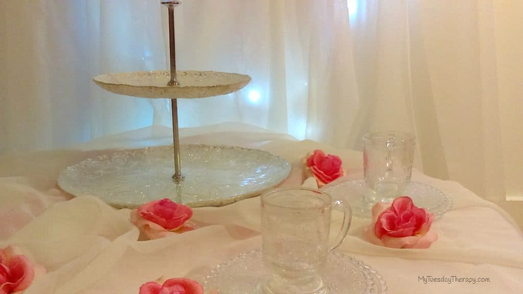 Fairy party table setting. Small glass tea cups. Sheers. Fairy lights. Pnk Flowers.