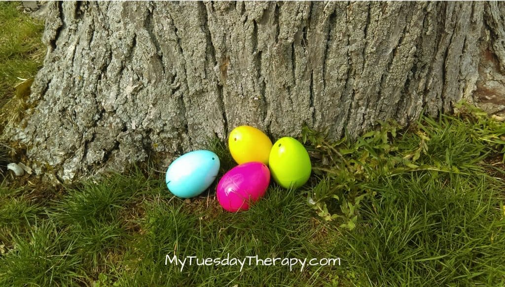 Spring Party Activity: Easter Egg Hunt. Easter eggs next to a tree.