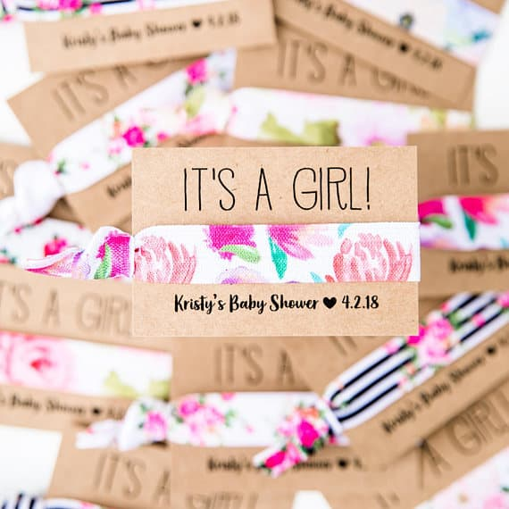 Easy Baby shower ideas. Baby shower favor ideas: hair tie (image credit Love Mia Co)