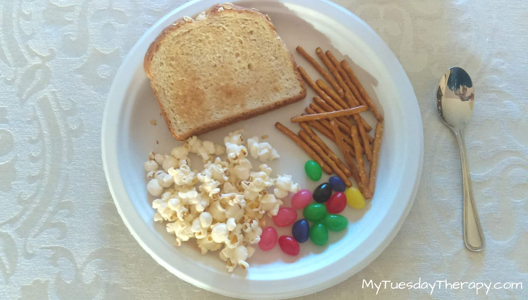 Did We Come Across Town For This? Charlie Brown Thanksgiving Dinner: toast, pretzel sticks, jelly beans, popcorn and ice cream.