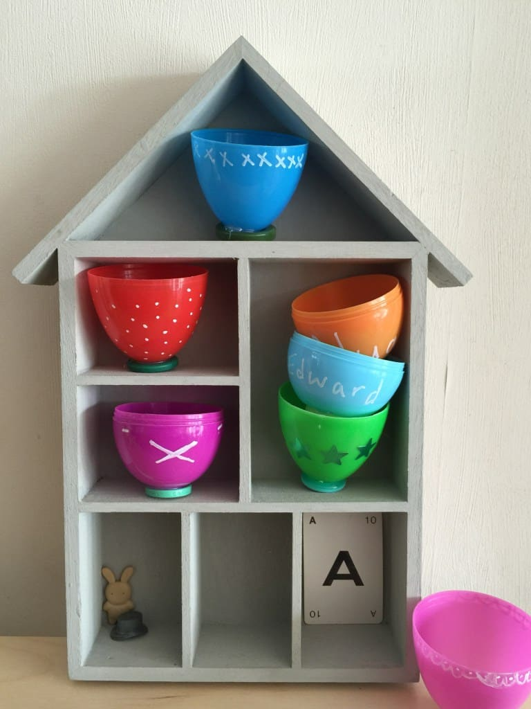 DIY Tea Cups Made With Easter Eggs and Buttons.