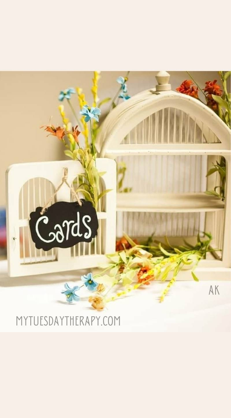 White Birdcage Card Holder with a Chalkboard Sign.