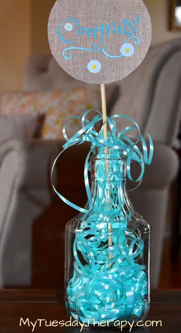 Easy Centerpiece Idea for Birthday Party. A glass vase filled with curling ribbon.