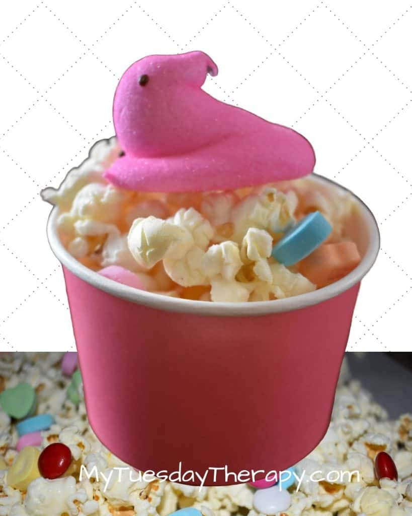 Valentine's Day Popcorn. A pink bowl filled with popcorn and a pink Peep on top.