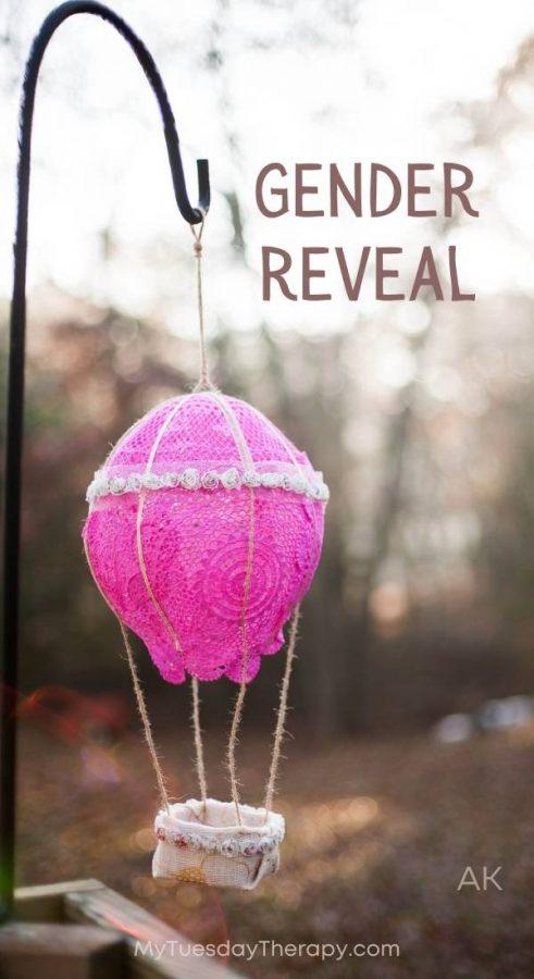 Pink hot air balloon as a gender reveal idea.