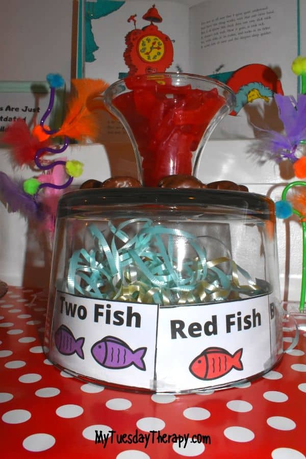 Dr. Seuss party treats: red fish in an upside down trifle bowl.