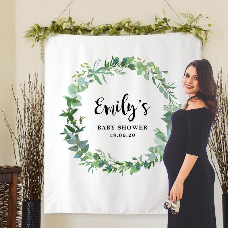 Baby Shower backdrop. Mom's name and the baby shower dateinside a greenery wreath