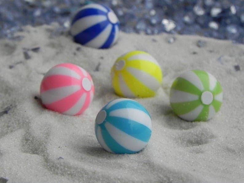 Miniature beach balls in assorted colors. Fun luau cupcake topper. (thelittlehedgerow)
