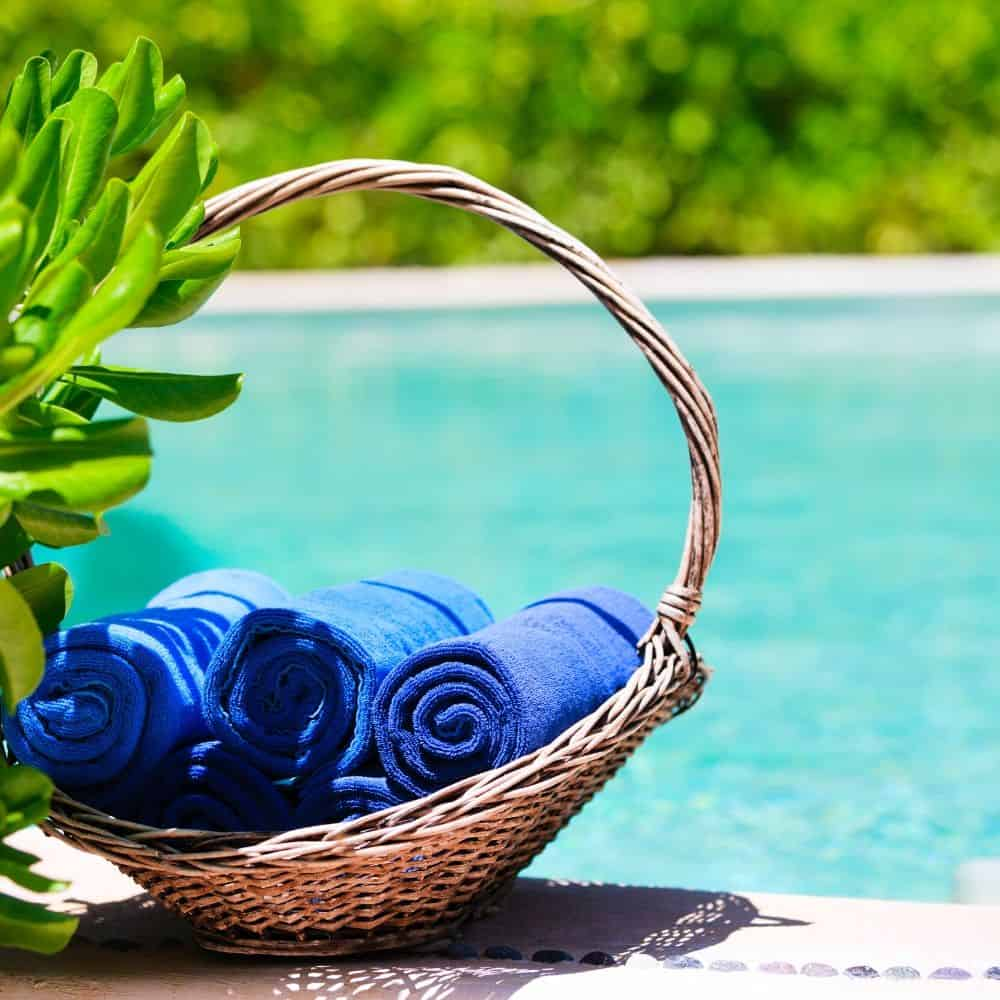 Towels in a basket for pool party.