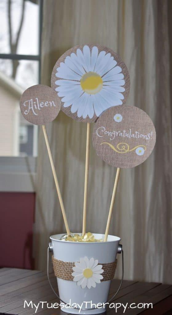Daisy party centerpiece sticks. DIY daisy party decor.