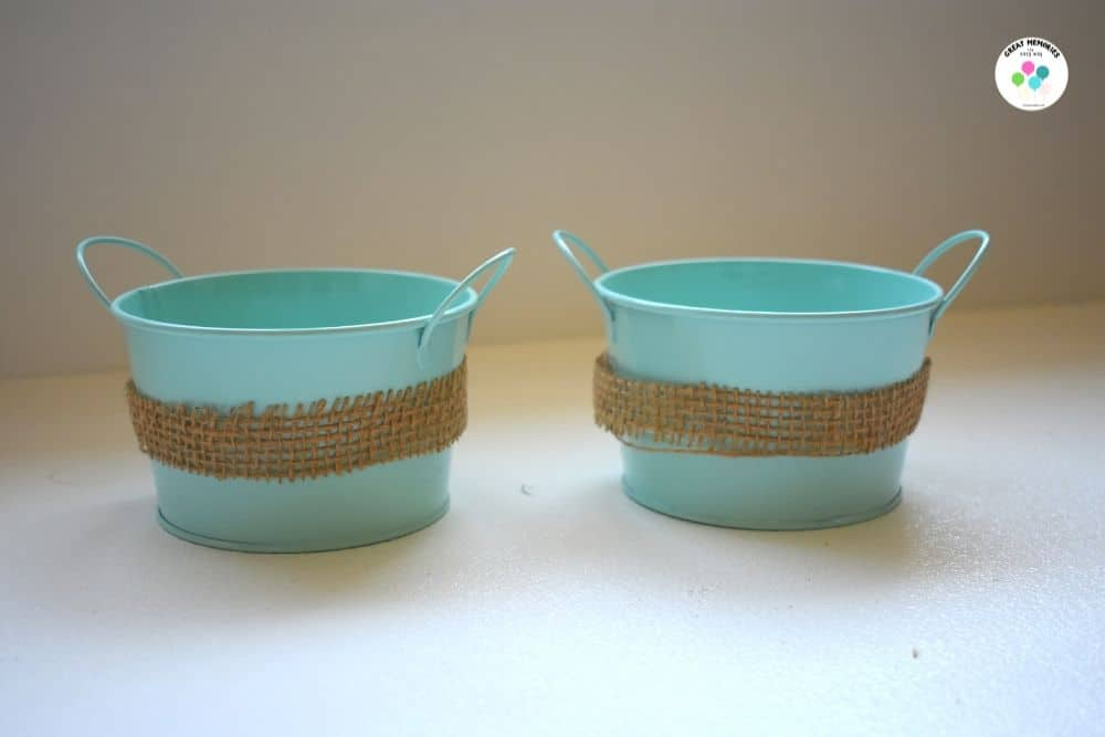 Robin egg colored buckets with burlap ribbon.