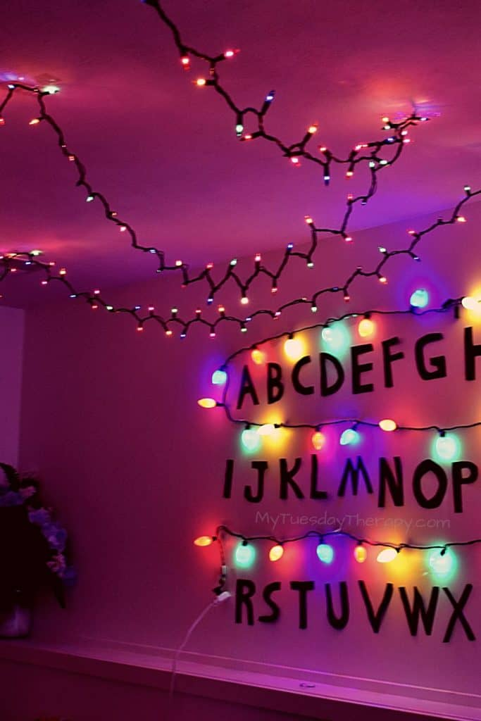 Christmas Lights as Stranger Things Party decoration. Easy and cheap decor idea for a party on a budget!