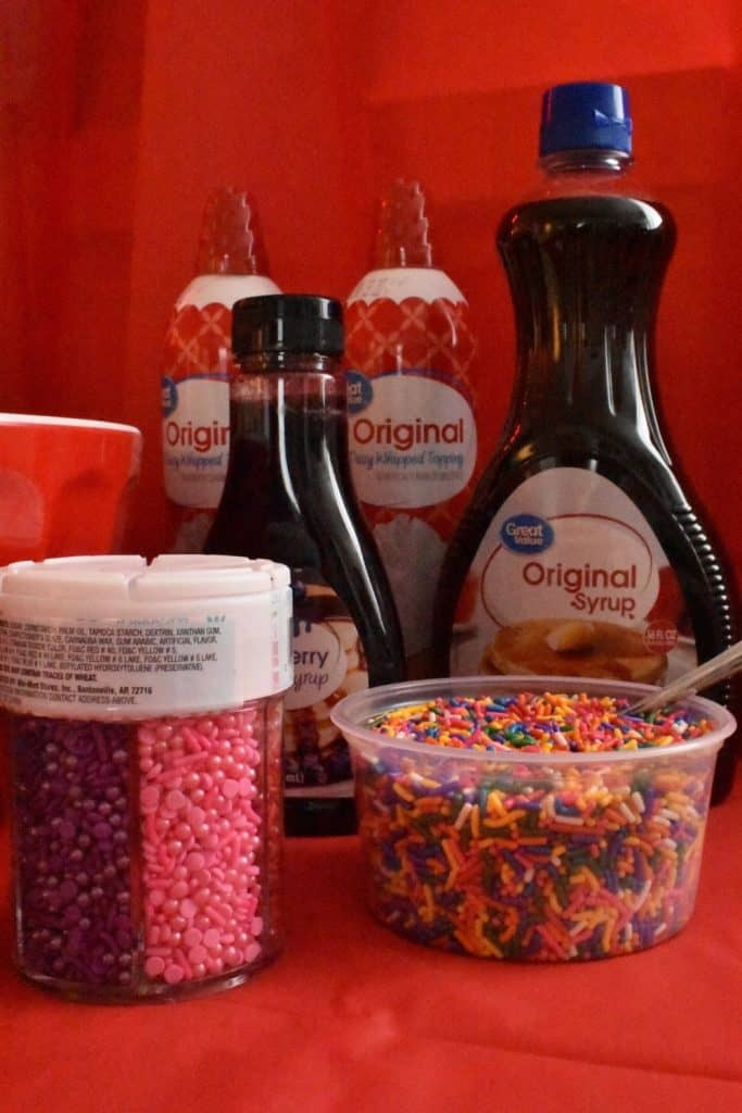 Waffle Bar topping ideas: blueberry syrup, sprinkles, whipped cream