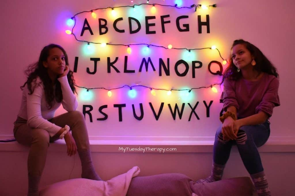 Stranger Things alphabet and Christmas lights backdrop for photos or food table.