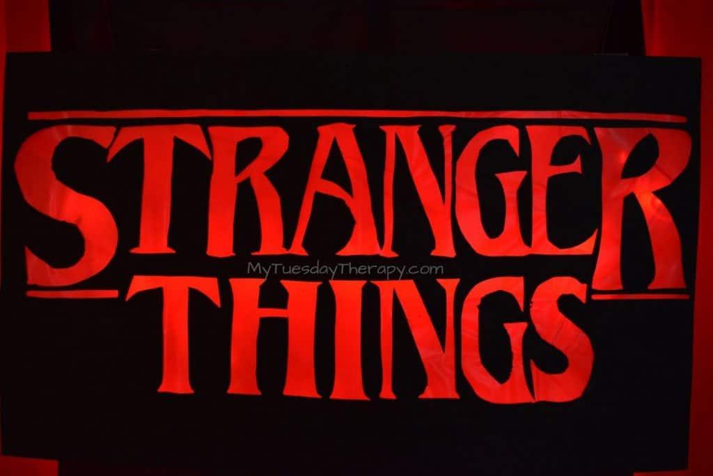 Stranger Things Sign DIY. Black background, red lights.