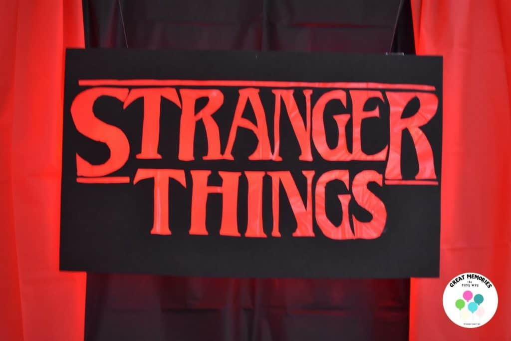 Stranger Things Sign DIY with lights. A fun backdrop for Stranger Things viewing party food table.