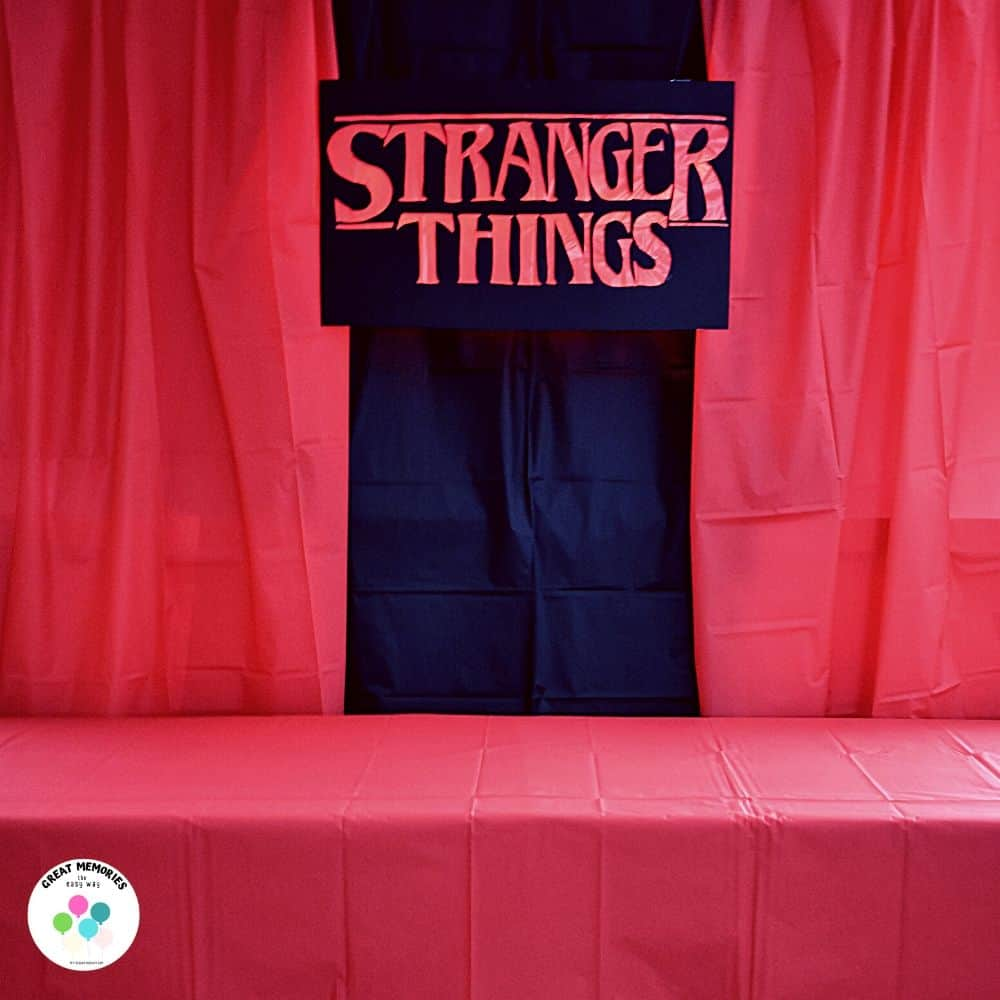 Stranger Things DIY Sign as a backdrop for food table at Stranger Things party